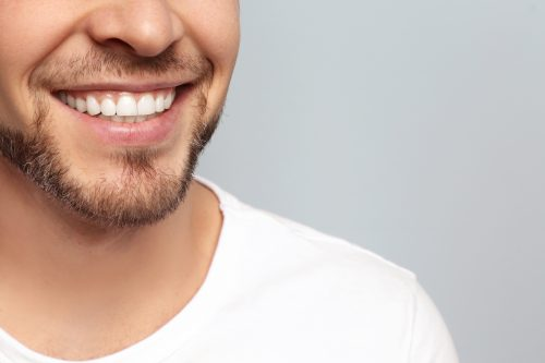 man with thin beard smiling