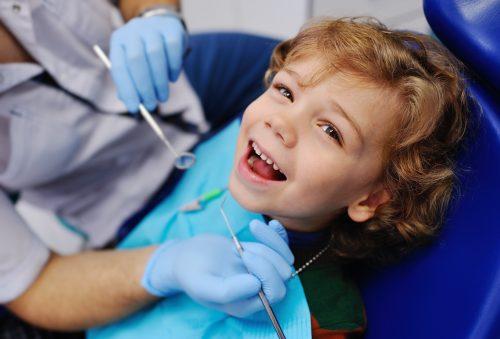 little boy in dentist chair