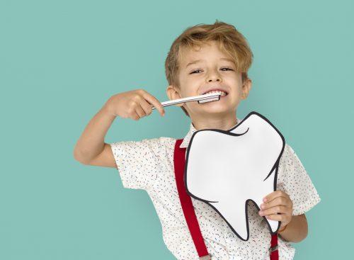 boy pretending to brush teeth